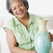African woman holding ceramic vase — Stock Photo #52070599