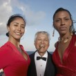 Senior man with two young women — Stock Photo #52070613