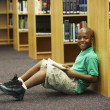 African American boy holding library book — Stock Photo #52070979