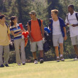 Multi-ethnic friends on golf course — Stock Photo #52071041