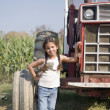 Hispanic girl next to tractor — Stock Photo #52071073