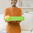 Mixed Race boy holding gift — Stock Photo #52071083
