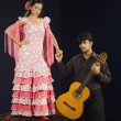 Hispanic female flamenco dancer holding hands with guitar player — Stock Photo #52071543