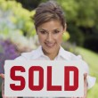 Hispanic woman holding Sold sign — Stock Photo #52071555