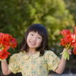������, ������: Asian girl holding bouquets of flowers
