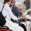 Hispanic couple on scooter — Stock Photo #52072131