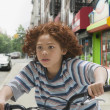 Mixed Race boy riding bicycle — Stock Photo #52072391