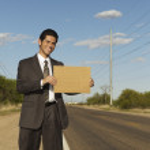 Hispanic businessman holding blank sign — Stock Photo #52072691