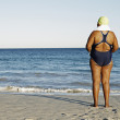 Mixed Race woman looking out at ocean — Стоковое фото #52072889