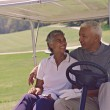 Senior African American couple in golf cart — Stock Photo #52073059