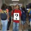 Student holding question mark sign — Stock Photo #52073065