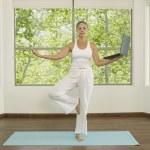 Asian woman practicing yoga — Stock Photo #52074289