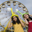 Multi-ethnic teenaged girls at carnival — Stock Photo #52074551