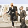 African American businesswoman getting off airplane — Stock Photo #52074559