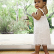 African baby standing next to window — Stock Photo #52074599