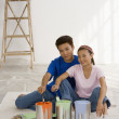 Asian couple with painting supplies — Stock Photo #52074661