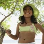Hispanic girl in bathing suit under tree — Stock Photo #52074867