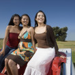 Mixed Race women sitting on convertible — Stock Photo #52076055