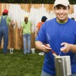 Mixed Race family painting fence — Stock Photo #52076161