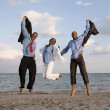 African businesspeople cheering at beach — Stock Photo #52076325