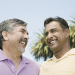 Hispanic men smiling at each other — Stock Photo #52076489