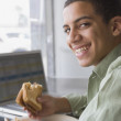 Mixed Race boy eating sandwich — Stock Photo #52077289