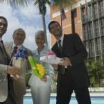 Hispanic businesspeople holding gifts — Stock Photo #52077473