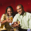 African couple toasting with cocktails — Stock Photo #52077635