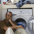 Young man doing laundry — Stock Photo #52077895