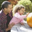 African father and daughter decorating pumpkin — Stock Photo #52078669