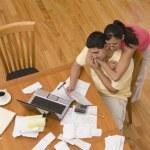 Hispanic couple paying bills — Stock Photo #52079359