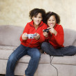African twin sisters playing video games — Stock Photo #52079533