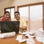 Hispanic couple paying bills — Stock Photo #52079601