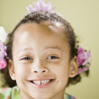 Close up of Mixed Race girl smiling — Stock Photo #52079731