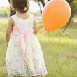 Mixed race toddler holding balloon — Stock Photo #52079909