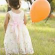 Mixed race toddler holding balloon — Stock Photo #52079909