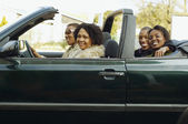 African couples driving in convertible car — Stock Photo