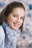 Teenaged girl wearing Christmas garland — Stock Photo