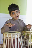Indian boy playing drums — Stock Photo