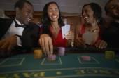Multi-ethnic couples gambling — Stock Photo