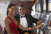 Couple next to slot machines — Stock Photo