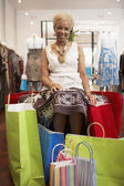Senior African American woman clothes shopping — Stock Photo
