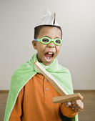 Mixed Race boy playing dress-up — Stock Photo
