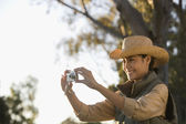 Asian woman taking photograph — Stock Photo