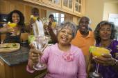 African seniors toasting at party — Stock Photo