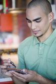 Man looking at electronic organizer — Stock Photo