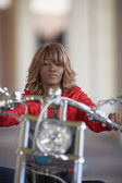African woman on motorcycle — Stock Photo
