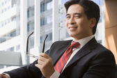 Confident Chinese businessman — Stock Photo