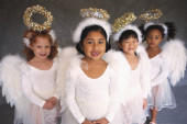Girls in angel costumes smiling — Stock Photo