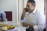 Hispanic man talking on cell phone — Stock Photo